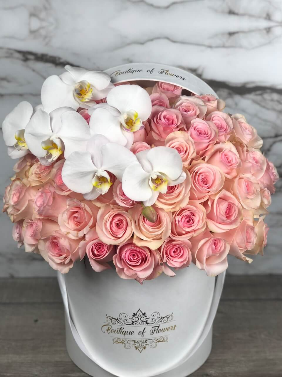 light pink rose with orchid round box